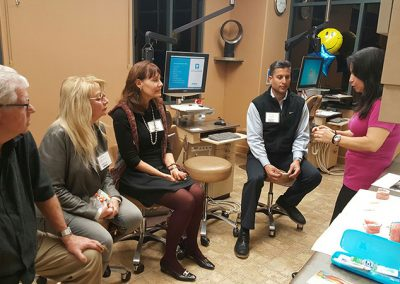 Olga discussing Damon braces and new patient visit information